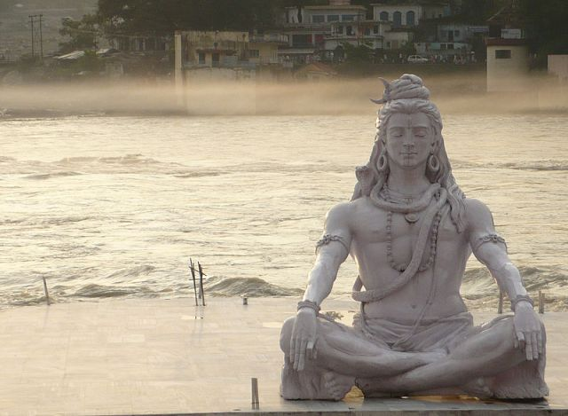 A statue of Shiva meditating on the Ganges River, rishikesh